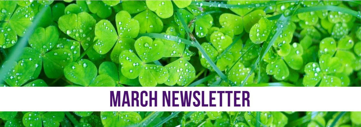 March 2019 Newsletter title over a pile of bright green clovers